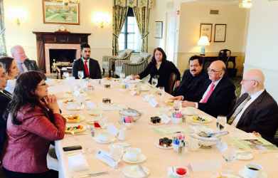 PDI Fellow Mohammed AlBader, seated at the head of the table, works as a Practice Manager for MetLife, Chicago. He participated in a business luncheon in Chicago for the President of the American University, Madaba (Jordan), Dr. George Hazboun, (right side, speaking). Also pictured: Talat Othman (far right), President of the Arab-American Business Professional Association, and H.E. Ihsan Sweiss (right side, left of Dr. Hazboun), Honorary Counsel for Jordan.
